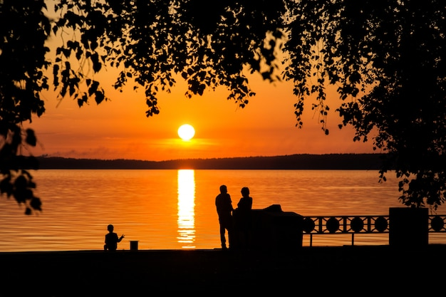 Silhouette of a couple in love at sunset or sunrise