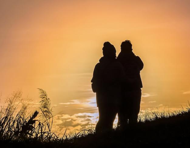 Silhouette couple  on the mountain