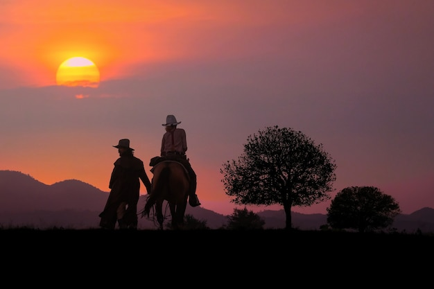The silhouette of the cowboy and the setting sun