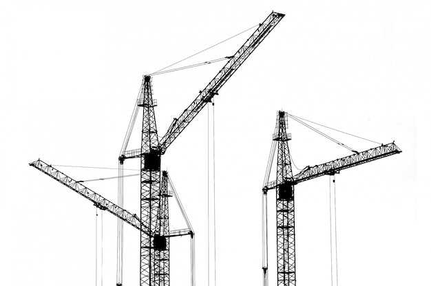 Silhouette of cranes at a construction site