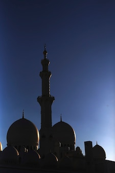 Silhouette of domes at abu dhabi grand mosque at sky background