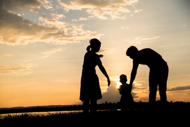 Silhouette of family happy parents having fun