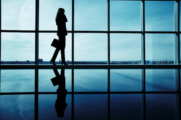 Silhouette of female executive with briefcase