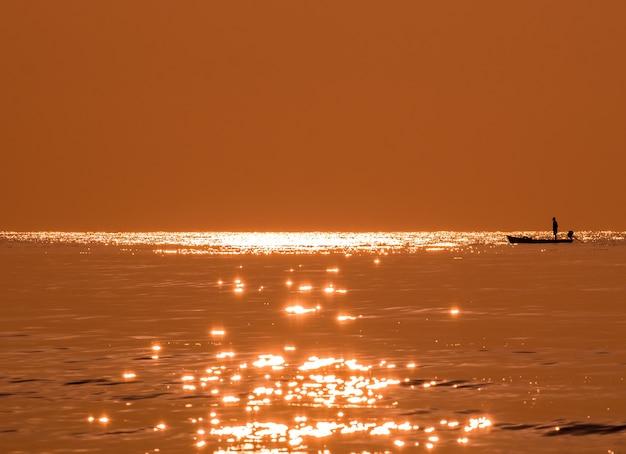 Silhouette fisherman fishing golden sea beautiful shine natural in morning