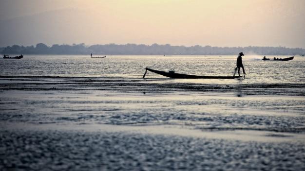 Silhouette fisherman at inle lake, myanmar