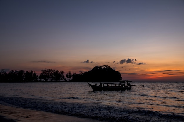 Silhouette, the fishing boat is to embed the evening.