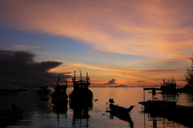 Silhouette of fishing boats at sunset