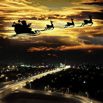 Silhouette of a flying goth santa claus against the background of the night sky elements of this ima