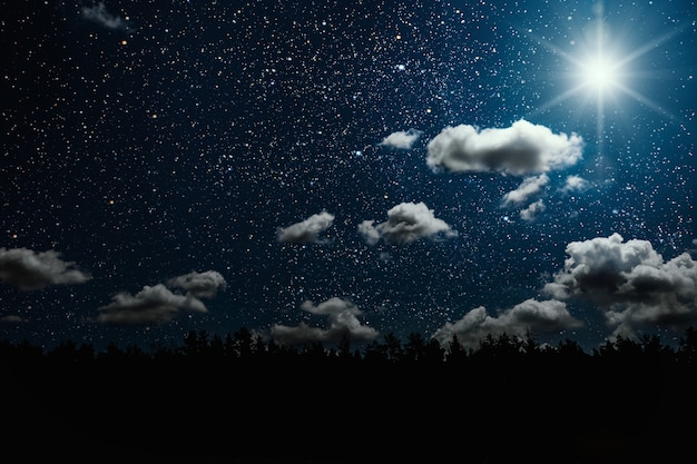 Silhouette of a flying goth santa claus against the background of the night sky. elements of this image furnished by nasa