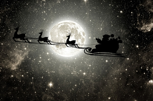 Silhouette of a flying goth santa claus against the background of the night sky