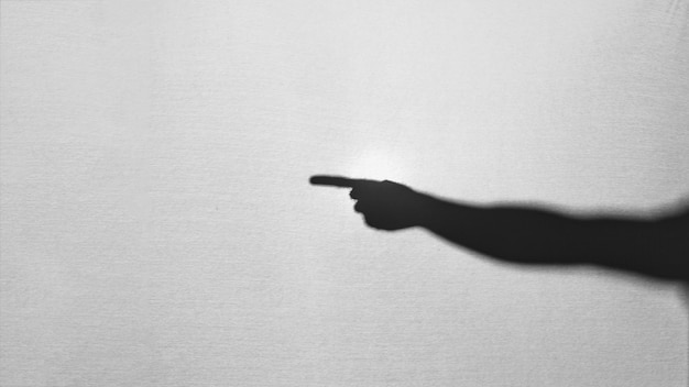 Silhouette of hand pointing aside