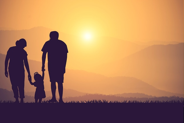 Silhouette of a happy family and happy time sunset