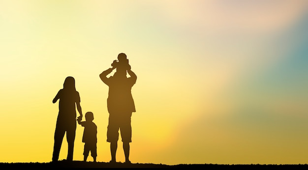 Silhouette happy family on mountains top