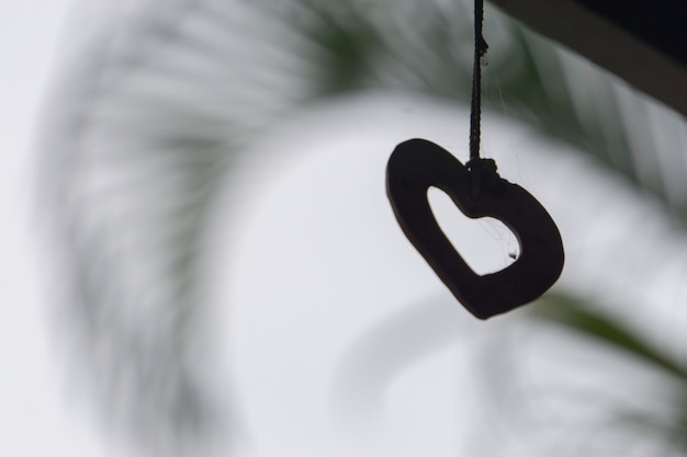 Silhouette heart shape at the sky nature background.