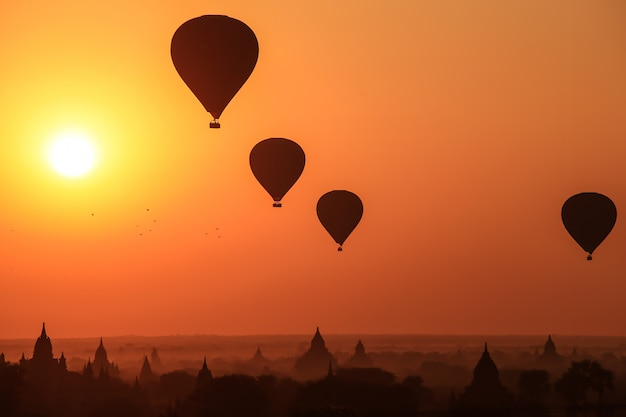 Silhouette of hot air balloon over bagan at sunrise in misty morning, myanmar