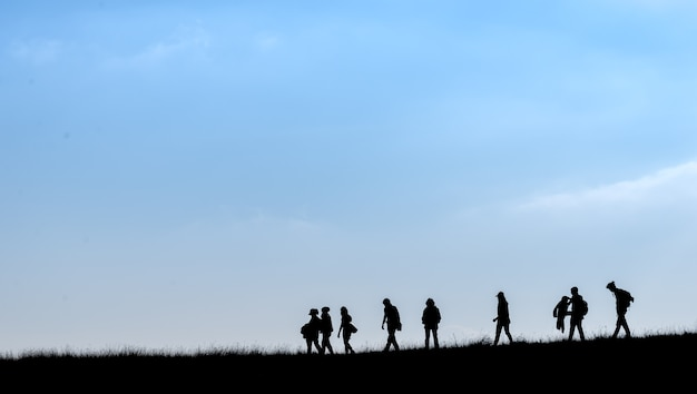 Silhouette of human scale hike and trail on mountain
