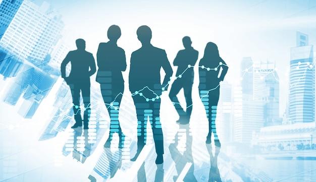 都市の背景にビジネスの人々のグループのシルエット画像