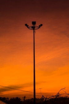 Silhouette image of sunrise on the roof