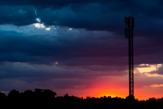 Silhouette images , multi-colored sky and telephone poles.