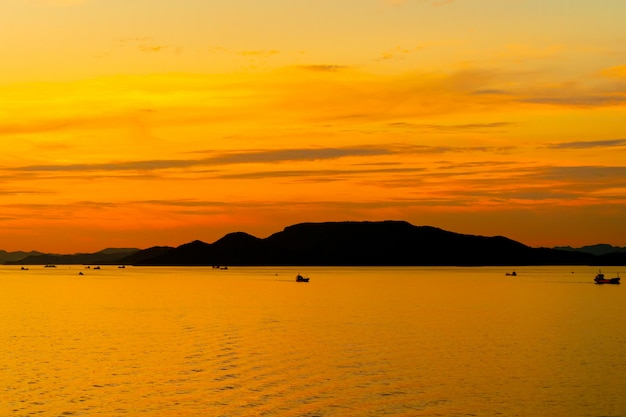 Silhouette island with sunset in colorful light background