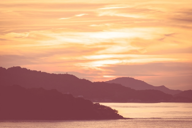 Silhouette island with sunset in colorful light