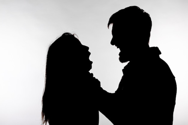 Silhouette of a man asphyxiating a woman.
