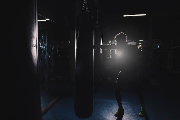 Silhouette of man boxing