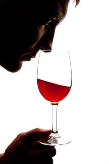Silhouette of man degusting wine. isolated on white