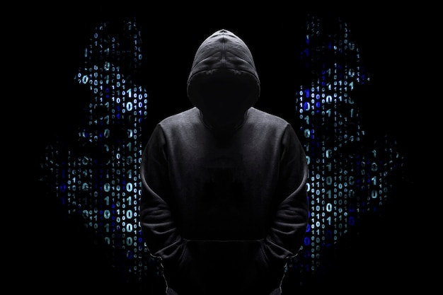 Silhouette of a man in a hood with wings from a binary code, concept angelic good hacker