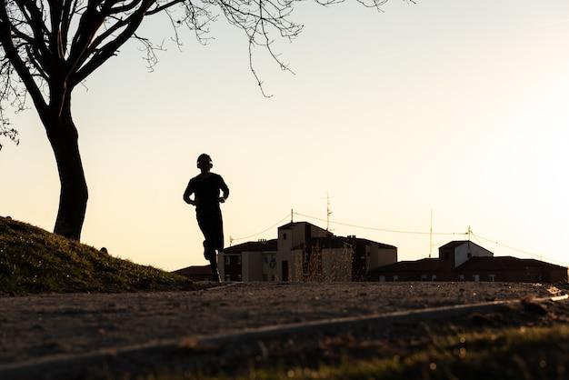 Silhouette of man running