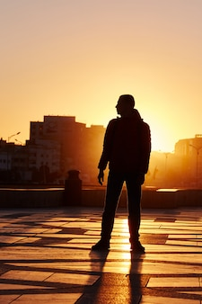 Silhouette of a man at sunset in winter