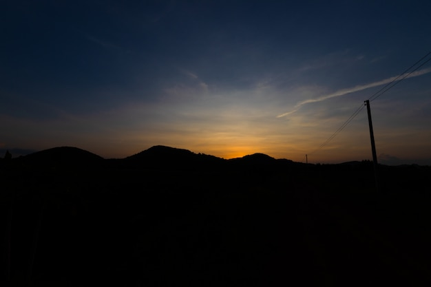 Silhouette mountain after sunset