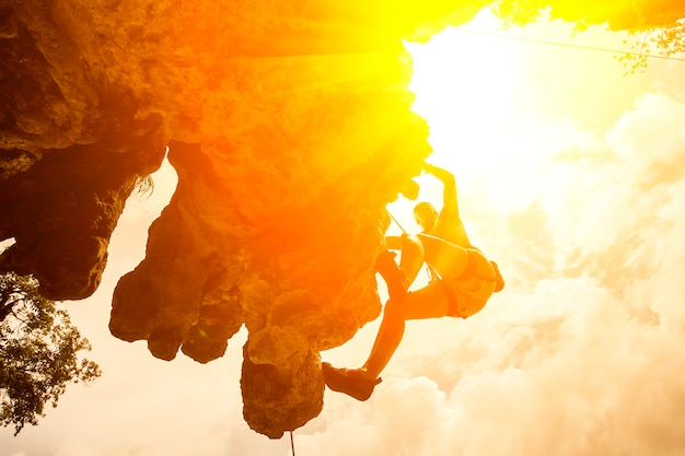 Silhouette of mountain climber at riley beach, krabi, thailand