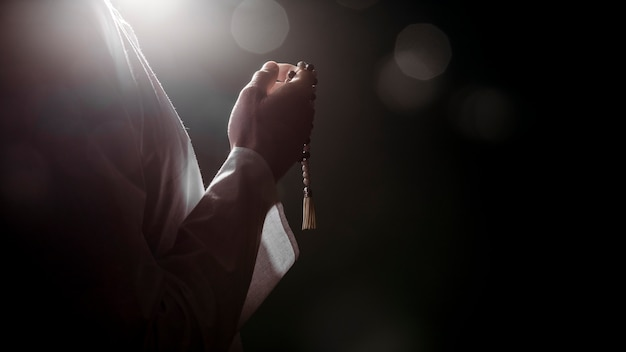 Silhouette of muslim woman praying