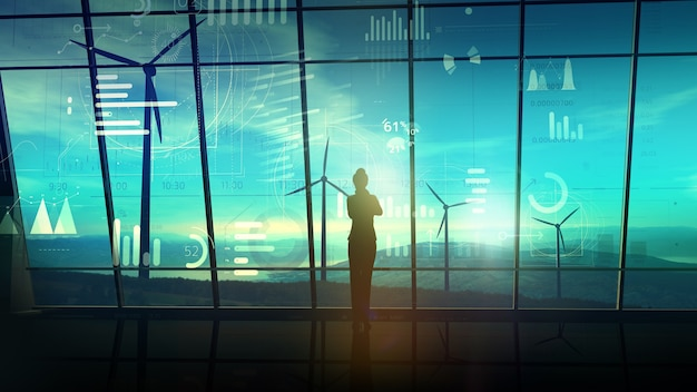 ビジネスウーマンのシルエットが風力発電所を見下ろす大きな窓のあるオフィスに立っており、その前に仮想インフォグラフィックがあります