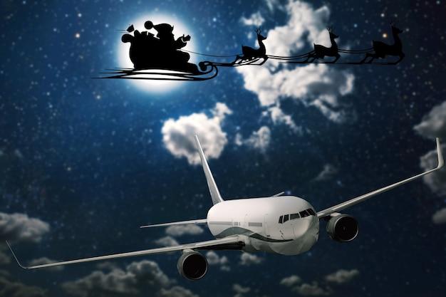 밤 sk의 배경에 비행 고트 산타 클로스의 실루엣