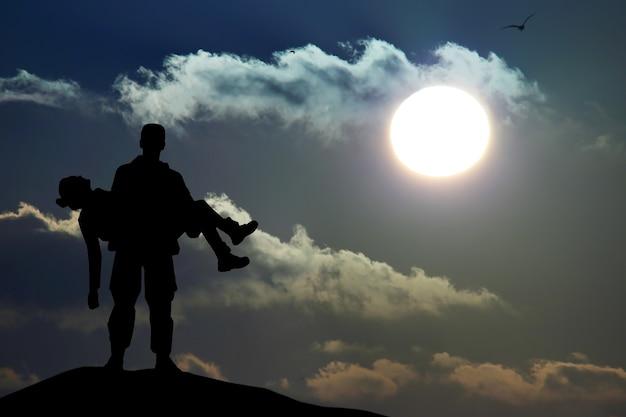 手に持っている兵士将校の男のシルエット女の子の女性