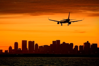 Silhouette of aircraft and cityscape