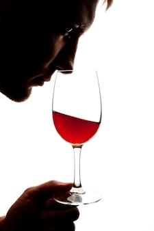 Силуэт человека дегустации вина. изолированные на белом