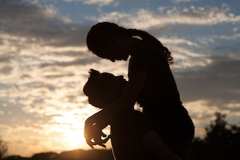 Silhouette of Romantic couple on the sunris