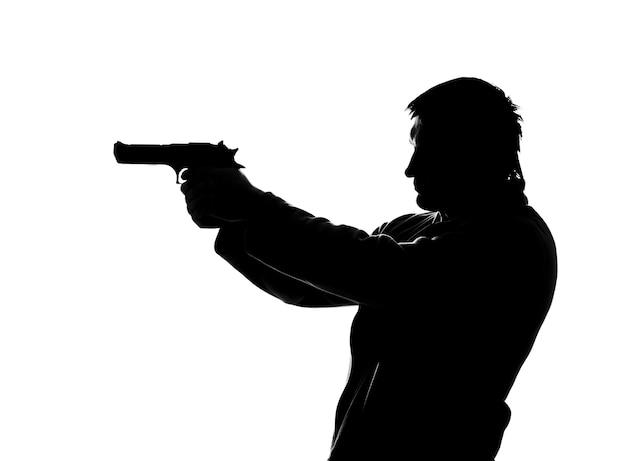 Силуэт стреляющего человека. изолированные на белом