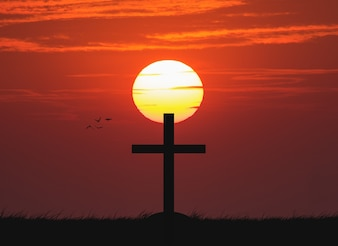 Silhouette of the cross with the sunset