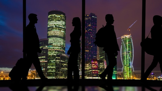 Silhouette of people on a panorama background