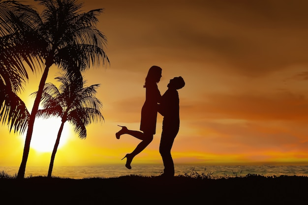 Silhouette of romantic couple in love with sunset view