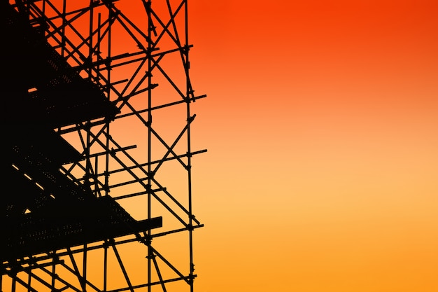 Silhouette of scaffolding on sunset sky