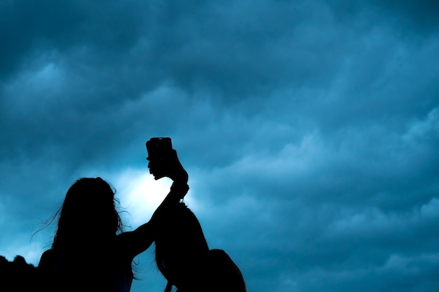 Silhouette selfie couple of young women