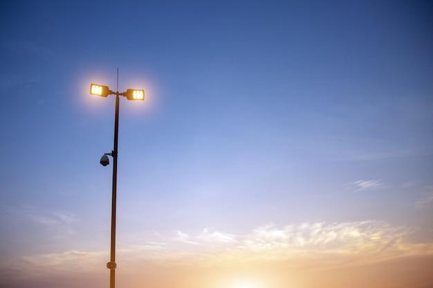 Silhouette spot light secerity camera on senset time