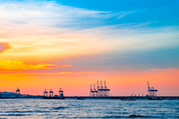 Silhouette sunset container seaport logistic import export and transport industry
