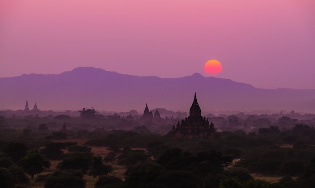 Silhouette sunset scene with pagoda field in bagan