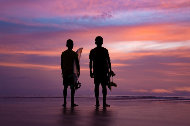 Silhouette surf athlete during sunset time at phuket thailand